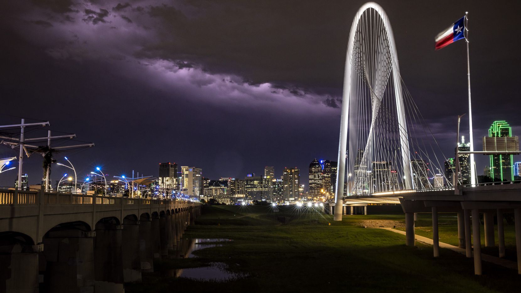 A lightning storm strikes in the backdrop of the skyline in downtown Dallas on Monday night, May 3, 2021.