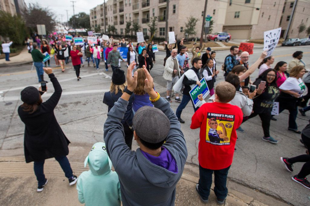 Supporters cheer participants in the Dallas Women's March at the Communications Workers of America Hall.