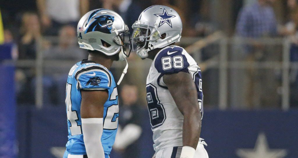 Carolina Panthers cornerback Josh Norman (24) and Dallas Cowboys wide receiver Dez Bryant (88) exchange pleasantries after Carolina's Kurt Coleman returned an interception for a touchdown in the first quarter during the Carolina Panthers vs. the Dallas Cowboys NFL football game at AT&T Stadium in Arlington, Texas on Thursday, November 26, 2015. (Louis DeLuca/The Dallas Morning News)