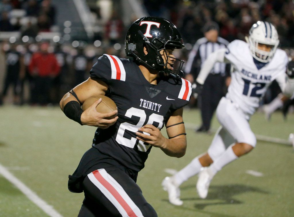 Euless Trinity's Jason Vaomotou (29) catches a pass a runs 72 yards for a touchdown against Richland during the first half of their high school football game on Friday Nov. 8, 2019. (Michael Ainsworth/Special Contributor)