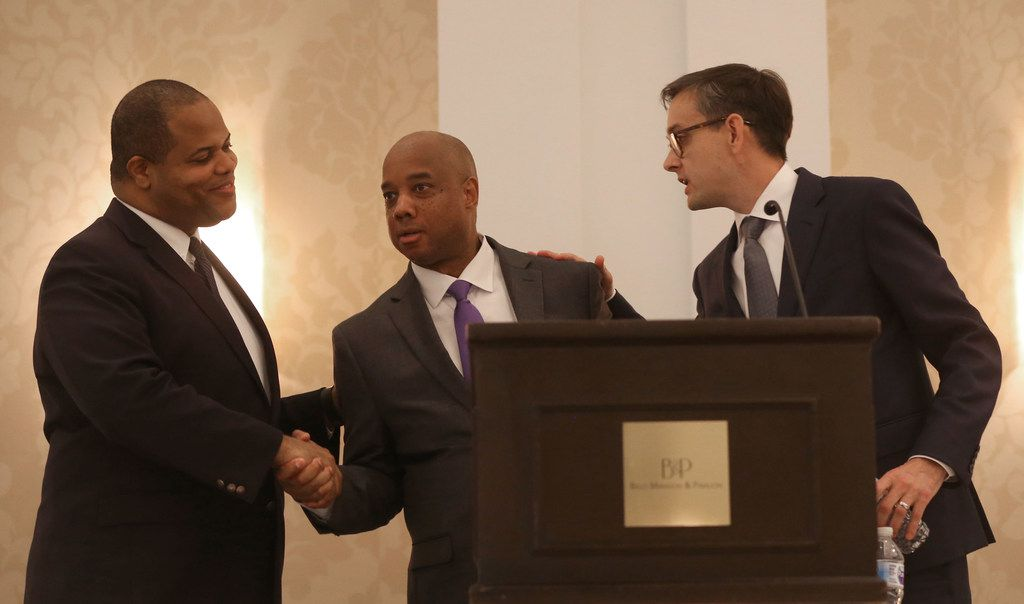 Candidates Eric Johnson (left) and Scott Griggs (right) shake hands with Dallas Morning News political reporter and moderator Gromer Jeffers, Jr. after a Dallas mayoral debate at the Belo Mansion in Dallas on Monday, May 13, 2019. The event was sponsored by the League of Women Voters of Dallas, the Dallas Friday Group and the Public Forum Committee of the Dallas Bar Association. (Rose Baca/The Dallas Morning News)