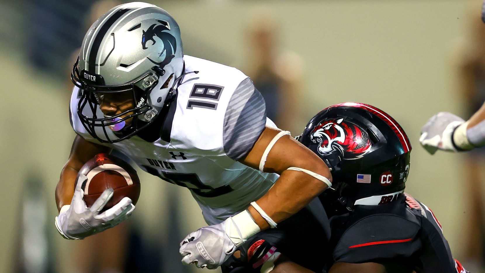 Denton Guyer kick returner Eli Bowen (18) is tackled by Denton Braswell linebacker Alan Tony-Itoyah (R) during the first half in a District 5-6A high school football game played at the C.H. Collins Complex on Friday, October 8, 2021, in Denton. (Steve Nurenberg/Special Contributor)