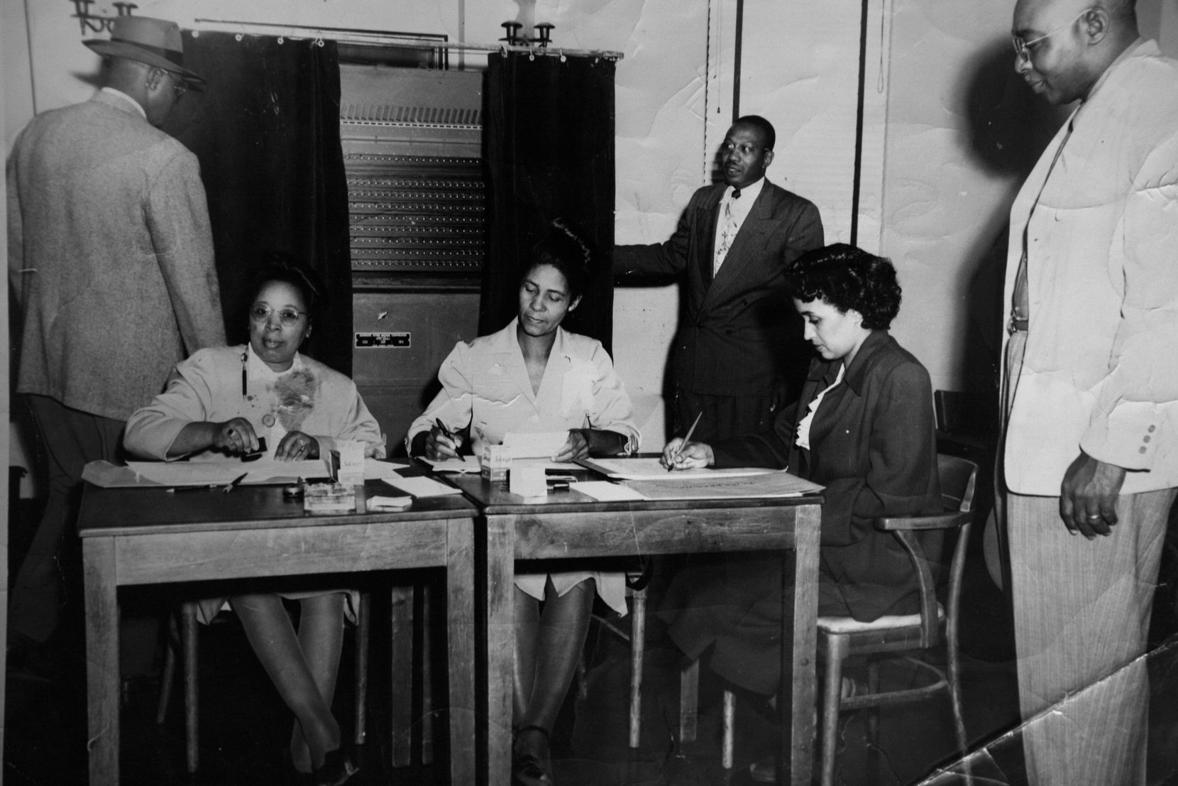 McMillan (second from right) is pictured as a 28-year-old election clerk at the Moreland Branch YMCA in 1949.