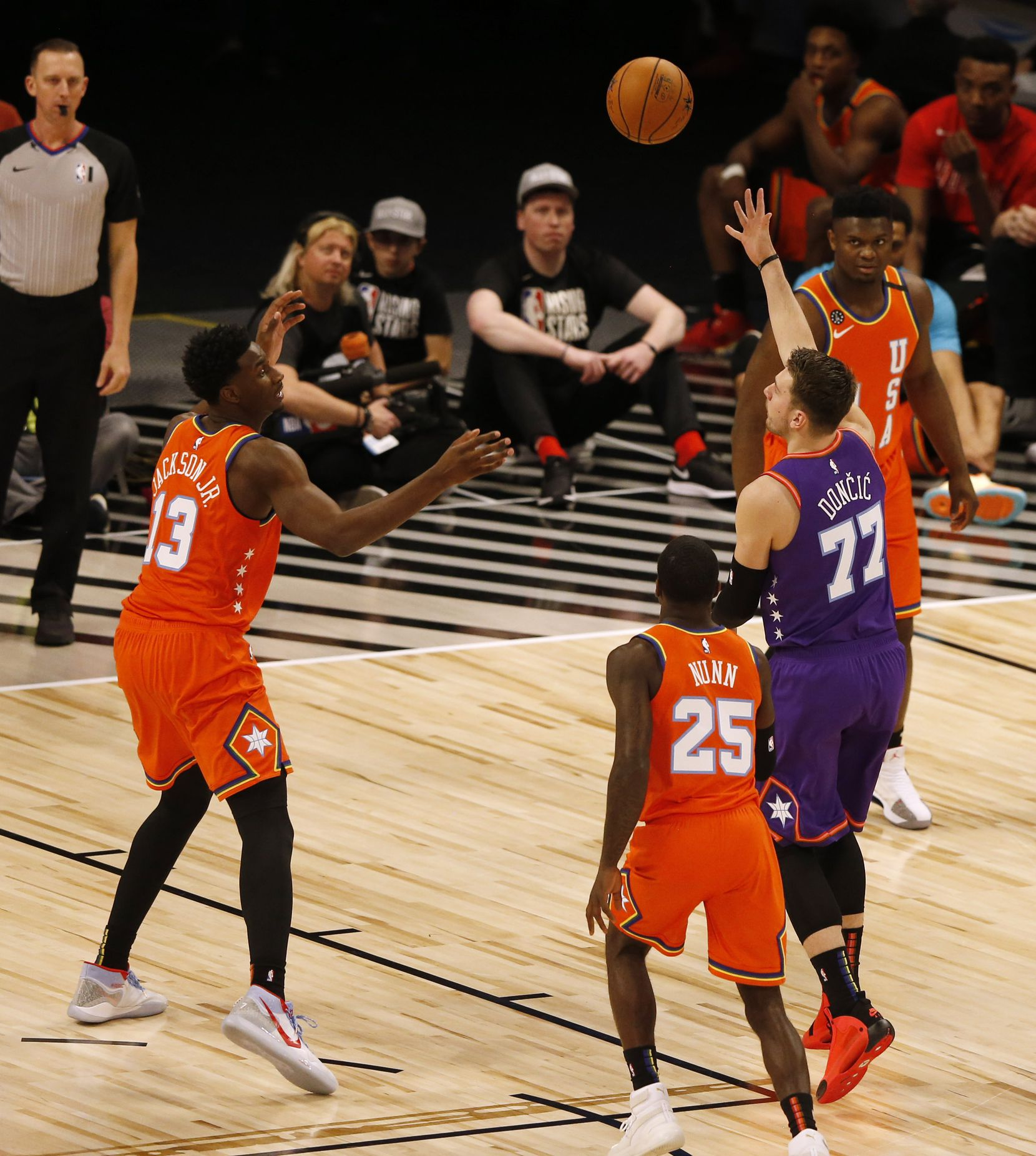 World Team and Dallas Maverickcks Luka Doncic (77) passes the ball in front of USA Team and Memphis Grizzlies Jaren Jackson Jr. (13) during the first half of play of the NBA Rising Stars game during the NBA All-Star 2020 at United Center in Chicago on Friday, February 14, 2020.