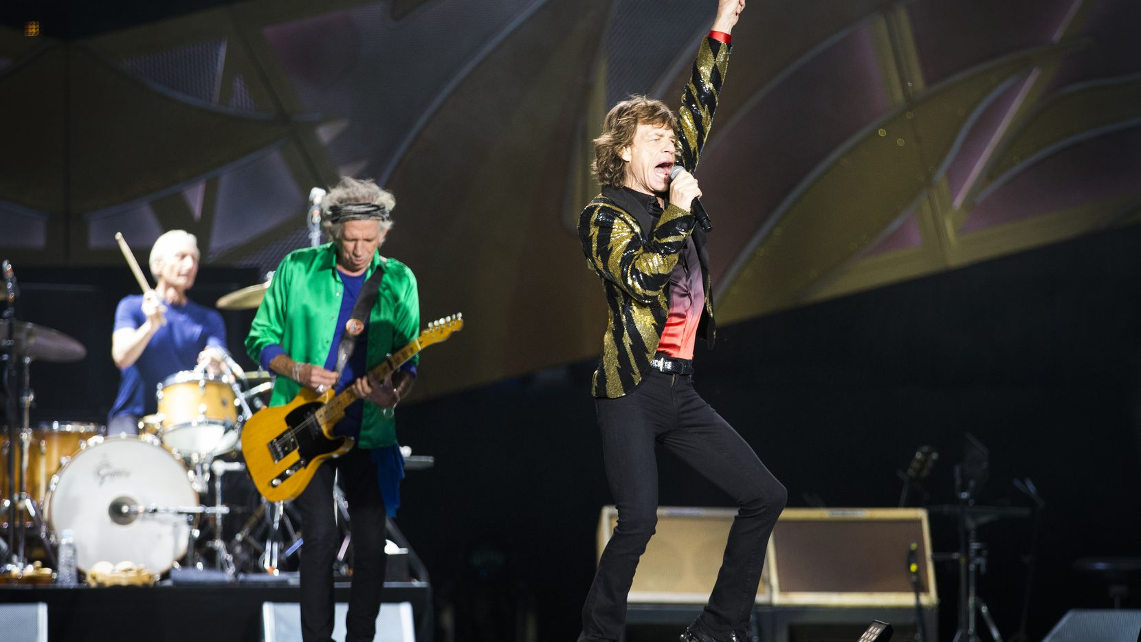Mick Jagger of the Rolling Stones performs with drummer Charlie Watts and guitarist Keith Richards at AT&T Stadium as part of their Zip Code Tour of North America on Saturday, June 6, 2015, in Arlington, Texas.