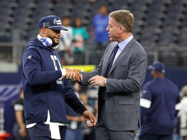 ARLINGTON, TEXAS - DECEMBER 15:  Dak Prescott #4 of the Dallas Cowboys shakes hands with FOX sportscaster and former Cowboys quarterback Troy Aikman before the game against the Los Angeles Rams at AT&T Stadium on December 15, 2019 in Arlington, Texas.