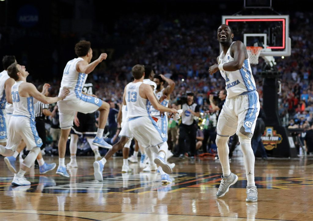 North Carolina forward Theo Pinson, right, celebrates at the end of the championship game against Gonzaga at the Final Four NCAA college basketball tournament, Monday, April 3, 2017, in Glendale, Ariz. North Carolina 71-65. (AP Photo/David J. Phillip)