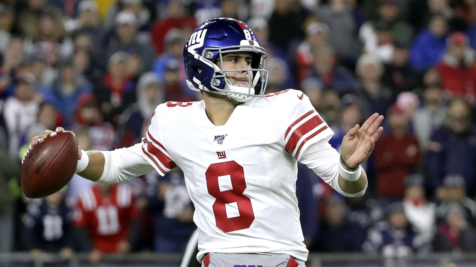 New York Giants quarterback Daniel Jones passes against the New England Patriots in the first half of an NFL football game, Thursday, Oct. 10, 2019, in Foxborough, Mass.