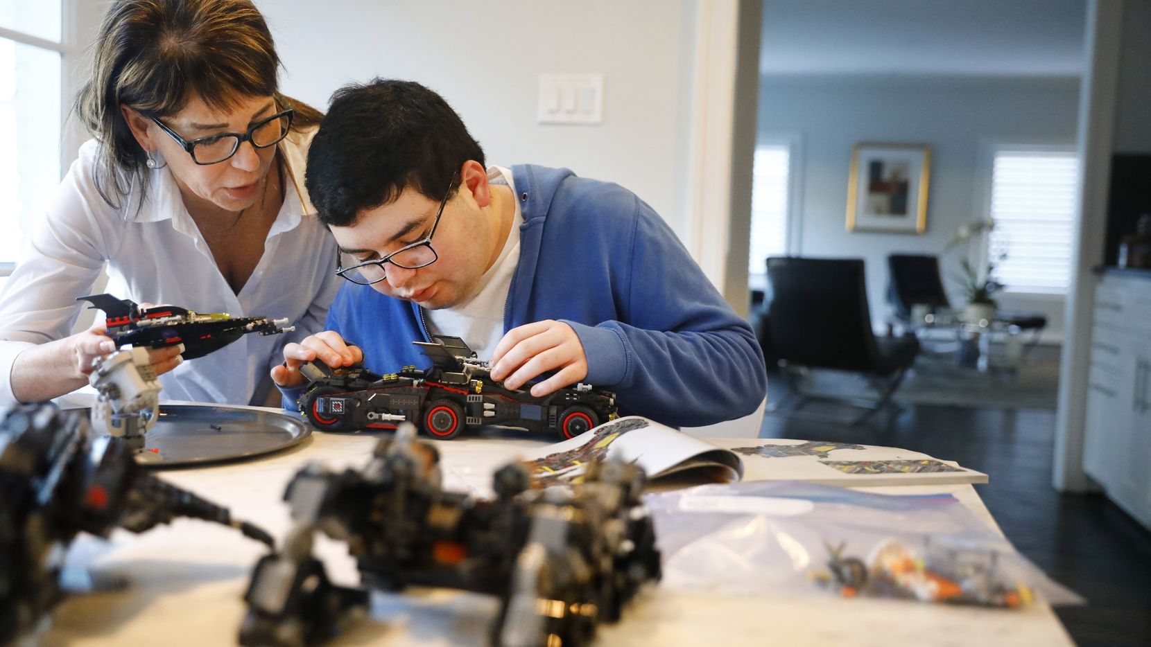Ingrid Basson lent a helping hand to her son Sam with a Lego project in February 2018, when they said he planned to live at a 29 Acres development in Denton County. 29 Acres provides housing and employment opportunities to adults with autism.