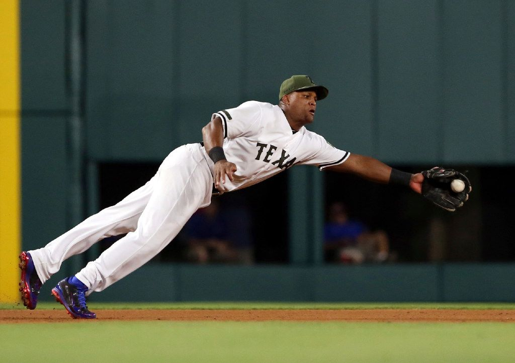 Texas Rangers third baseman Adrian Beltre (29) makes a diving catch on a ball hit by Tampa Bay Rays Derek Norris in the seventh inning of a baseball game in Arlington, Texas, Monday, May 29, 2017. (AP Photo/Richard W. Rodriguez)