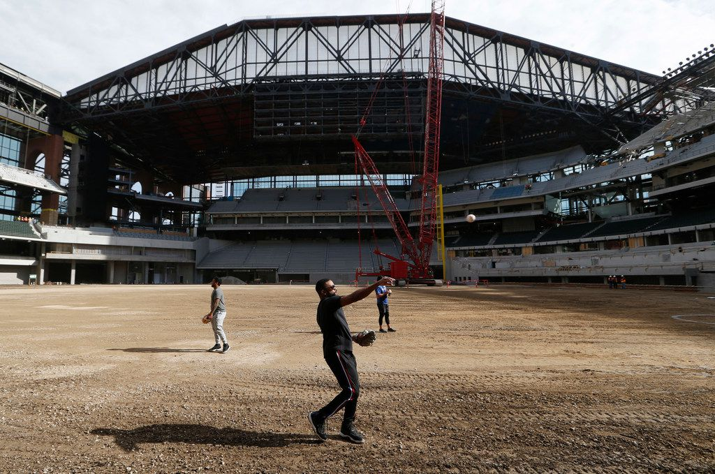 Texas Rangers Delino DeShields throws the baseball to a teammate at Globe Life Field in Arlington, Texas on Wednesday, December 4, 2019. The field still under construction opens next season. (Vernon Bryant/The Dallas Morning News)