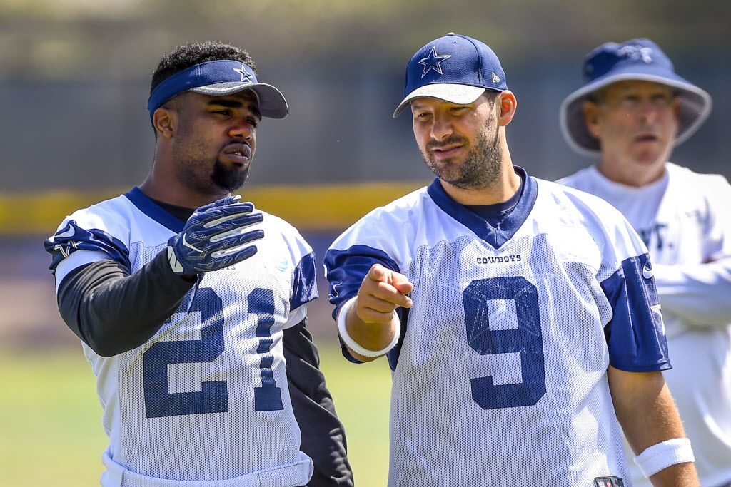 Dallas Cowboys running back Ezekiel Elliott (21) and teammate quarterback Tony Romo (9) talk a play over during practice at the NFL football team's training camp in Oxnard, Calif., Tuesday, Aug. 2, 2016. (AP Photo/Gus Ruelas)