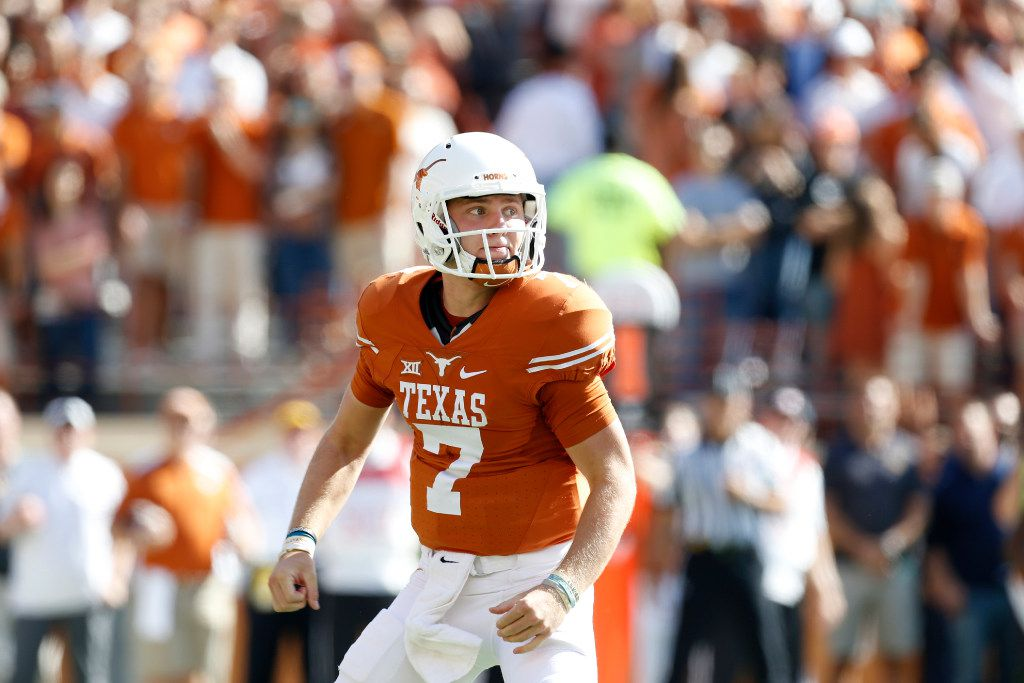 FILE - Texas quarterback Shane Buechele (7) looks to the sidelines during a game against West Virginia at Darrell K Royal-Texas Memorial Stadium in Austin on Nov. 12, 2016. (Nathan Hunsinger/The Dallas Morning News