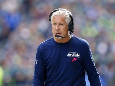 Seattle Seahawks head coach Pete Carroll walks the sideline during his game with the Dallas Cowboys at CenturyLink Field in Seattle, Sunday, October 12, 2014.