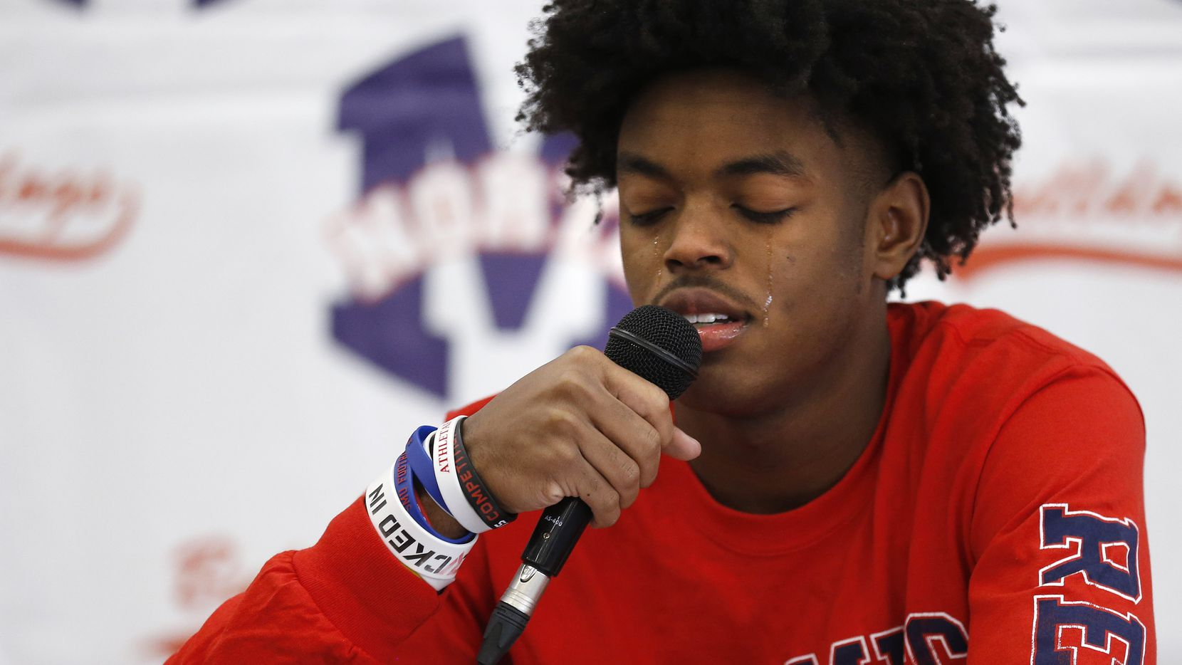 McKinney North wide receiver J.J. Henry cries as he talks about losing his mother to breast cancer during a signing day ceremony at McKinney North High School on Wednesday, December 16, 2020 in McKinney, Texas. Henry signed his letter of intent to play for the University of Mississippi.