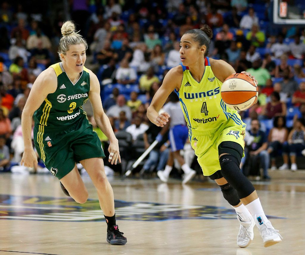 Dallas Wings guard Skylar Diggins-Smith (4) drives the ball past Seattle Storm guard Sami Whitcomb (3) during the first half at College Park Center in Arlington, Texas, Saturday, July 1, 2017. (Jae S. Lee/The Dallas Morning News)