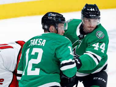 Dallas Stars defenseman Joel Hanley (44) and center Radek Faksa (12) send Carolina Hurricanes center Cedric Paquette (18) flying as he tried to score on goaltender Anton Khudobin (35) during the first period at the American Airlines Center in Dallas, Tuesday, April 27, 2021.