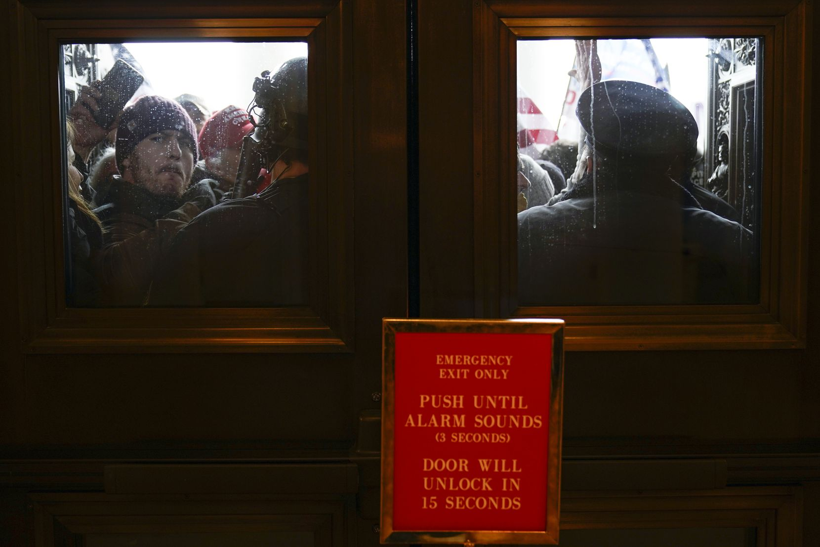 U.S. Capitol Police try to hold back protesters outside the east doors to the House side of the U.S. Capitol, Wednesday, Jan 6, 2021.