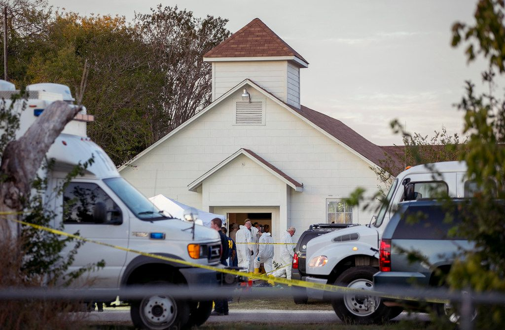 Investigators worked at the scene of the deadly shooting at the First Baptist Church in Sutherland Springs on Nov. 5. A Defense Department oversight allowed a former Air Force member to buy a high-powered rifle and shoot 26 people to death at the church.