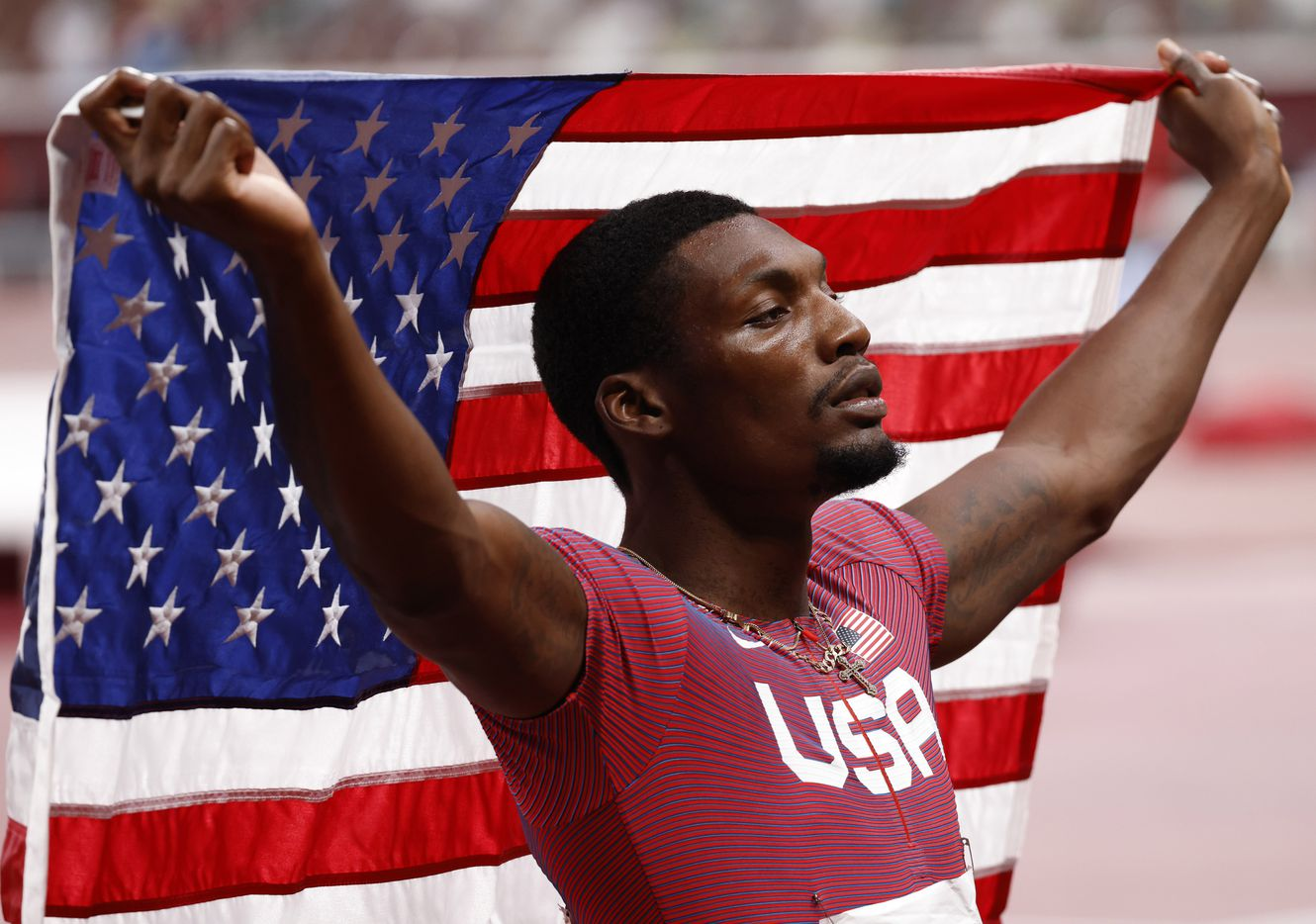 USA's Fred Kerley celebrates after finishing in second place in the men's 100 meter final during the postponed 2020 Tokyo Olympics at Olympic Stadium, on Sunday, August 1, 2021, in Tokyo, Japan. Kerley took second place with a time of 9.84 seconds. (Vernon Bryant/The Dallas Morning News)
