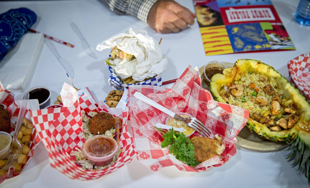 Piles of consumed entries lie on a table next to judge Don Gay, a professional bull rider, during the 2016 Big Tex Choice Awards Sunday, August 28, 2016 at Fair Park in Dallas. The annual event, held ahead of the State Fair of Texas, recognizes the best fried foods entered into consideration for sale at the fair. (G.J. McCarthy/The Dallas Morning News)