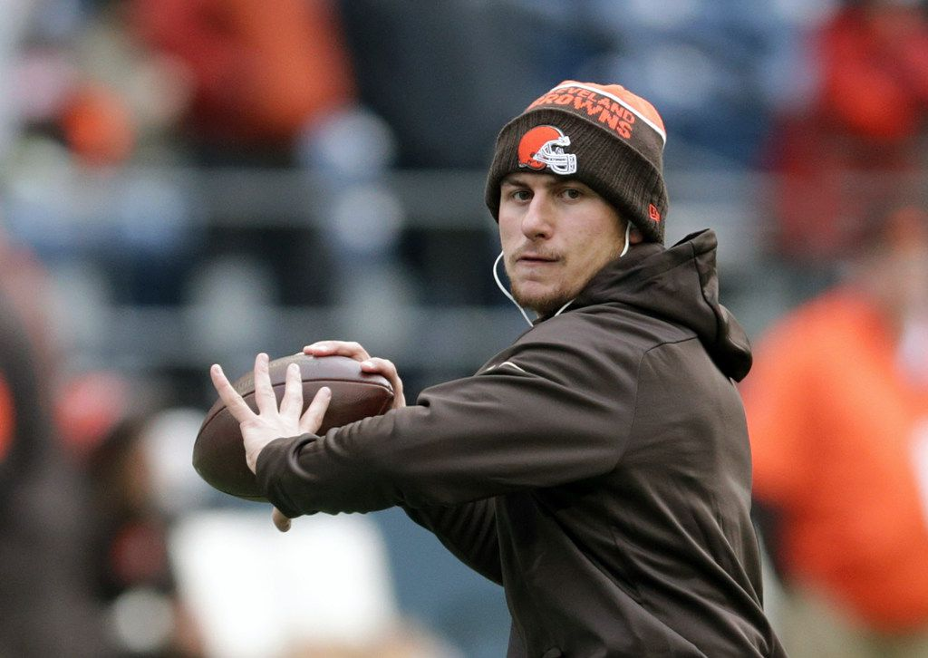 FILE - In this Dec. 20, 2015, file photo, Cleveland Browns quarterback Johnny Manziel warms-up before an NFL football game against the Seattle Seahawks, in Seattle. Former Heisman Trophy-winning quarterback Johnny Manziel says he's making a football comeback. Manziel announced Wednesday, Feb. 14, 2018,  that he will participate in the developmental Spring League in Austin, Texas, which will play from March 28 to April 15. The league is designed for players hoping to impress NFL scouts. The league confirmed Manziel will participate.  (AP Photo/Scott Eklund, File)