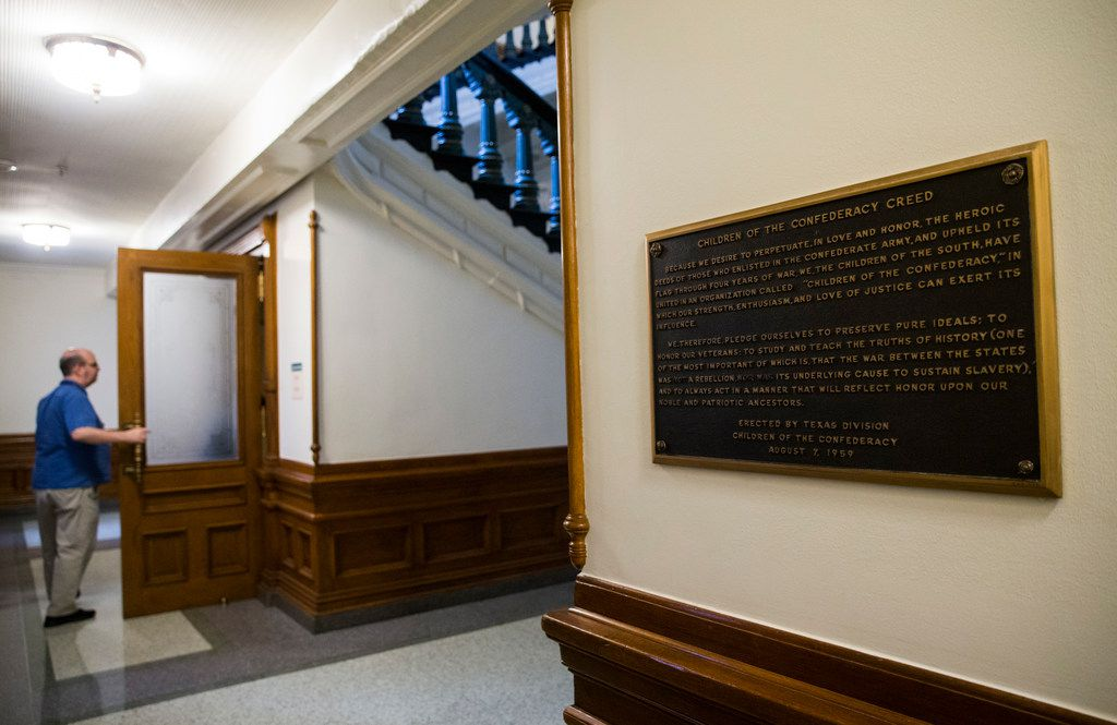 """A plaque entitled """"Children of the Confederacy Creed"""" hangs in a hallway on the ground floor of the Texas state capital on the third day of the 86th Texas legislature on Thursday, January 10, 2019 in Austin, Texas."""