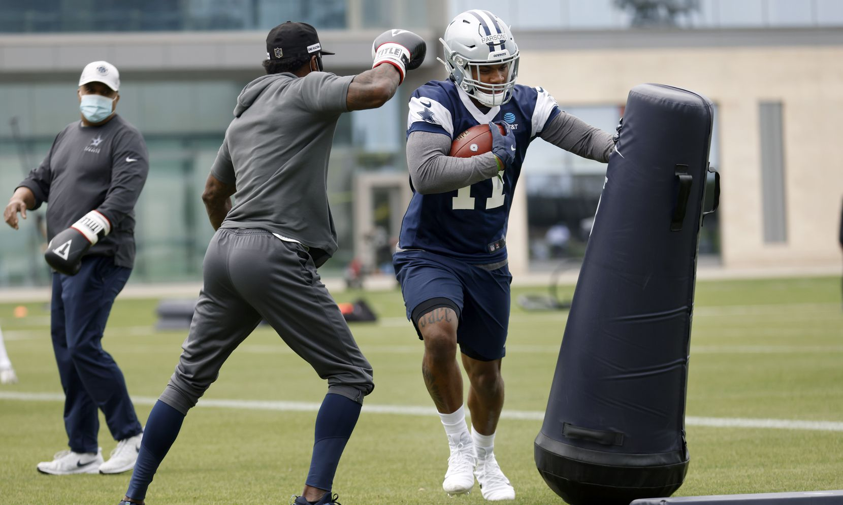 Dallas Cowboys rookie linebacker Micah Parsons (11) runs through drills during rookie minicamp at the The Star in Frisco, Texas, Friday, May 14, 2021. (Tom Fox/The Dallas Morning News)