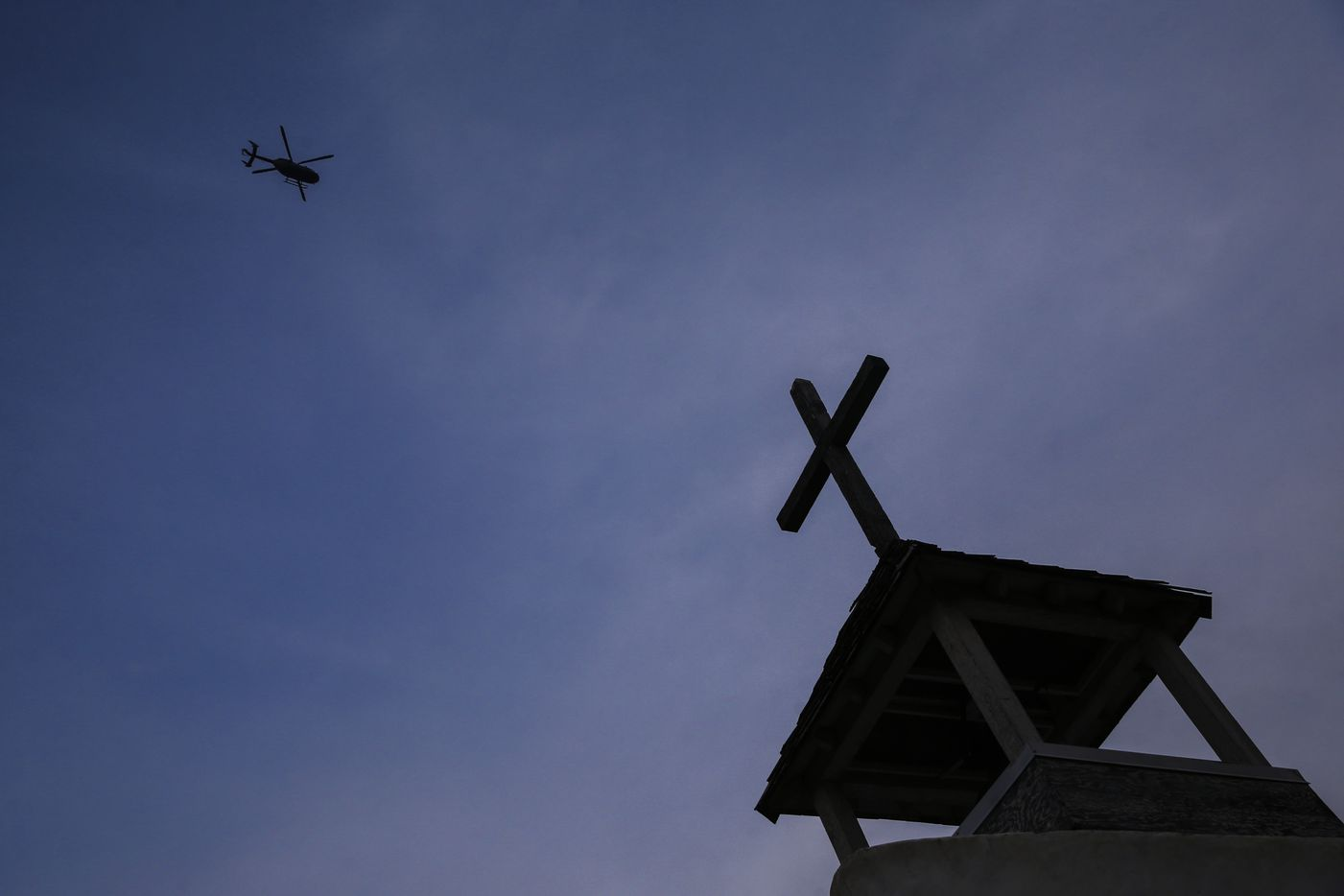 A Department of Homeland Security helicopter passes over the historic La Lomita chapel while patrolling the border near Mission, Texas.