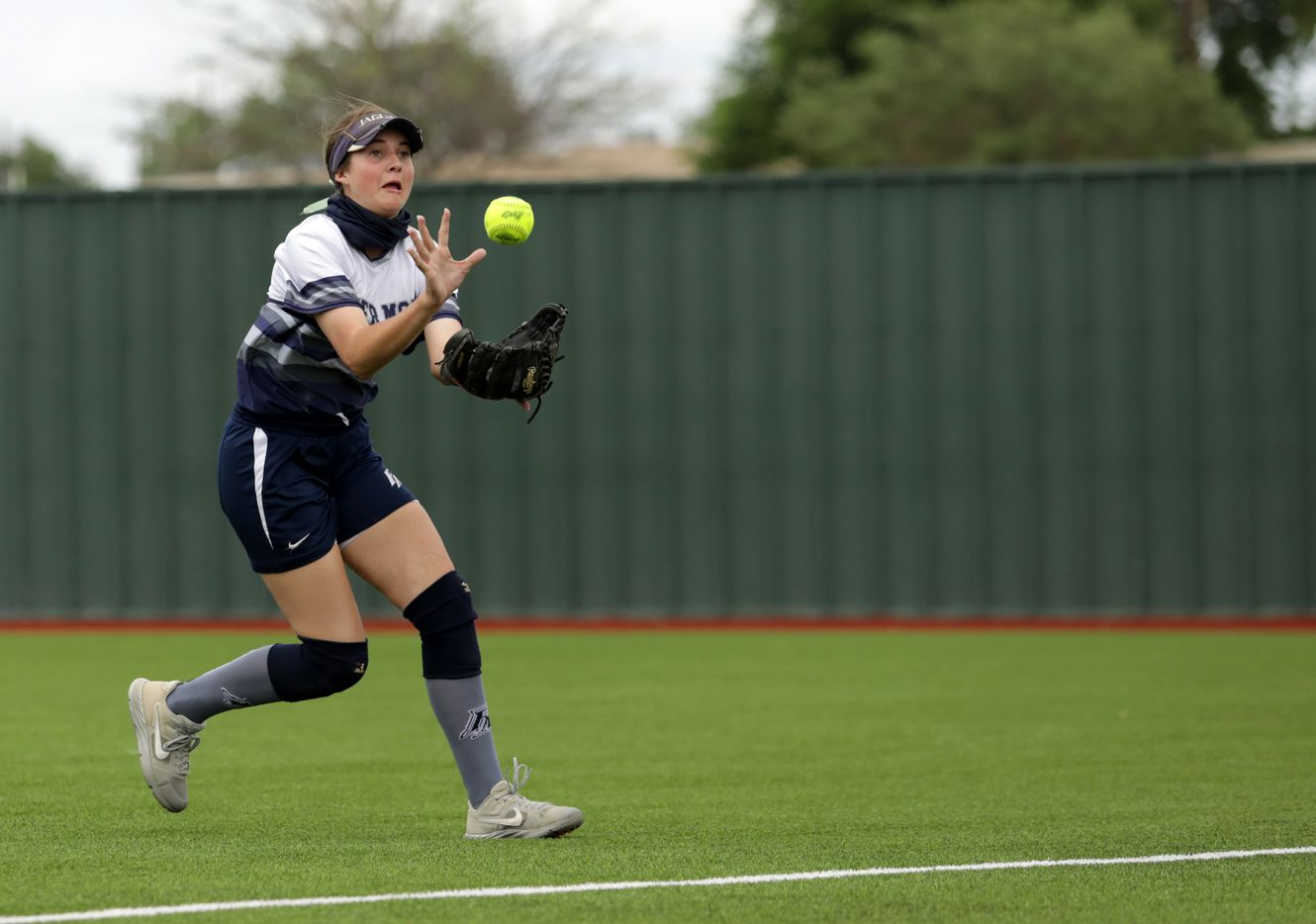 Flower Mound High School player #23, Courtney Cogbill, snags the ball during a softball game against Allen High School at Allen High School in Allen, TX, on May 15, 2021. (Jason Janik/Special Contributor)
