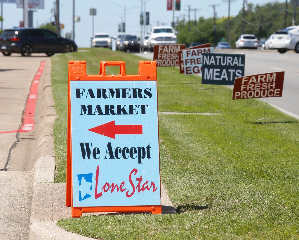 Signs along Garland Road points the way to the White Rock Lake Farmers Market