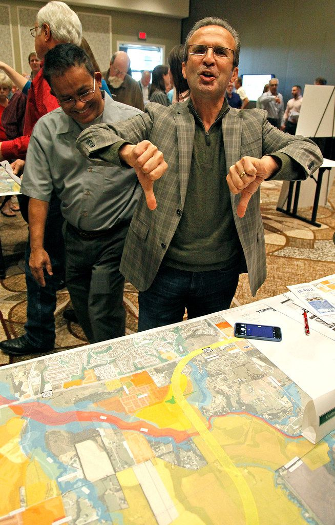 TxDOT professional engineer Nazrul Chowdhury (left) looks on while McKinney property owner Alan Hashem of Plano expresses his clear displeasure over a TxDOT route proposal. (Stewart F. House/Special Contributor)