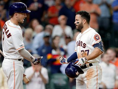 Houston Astros' Alex Bregman, left, and Jose Altuve celebrate Altuve's home run during the seventh inning of the team's baseball game against the Texas Rangers on Wednesday, Sept. 18, 2019, in Houston. (AP Photo/Michael Wyke)