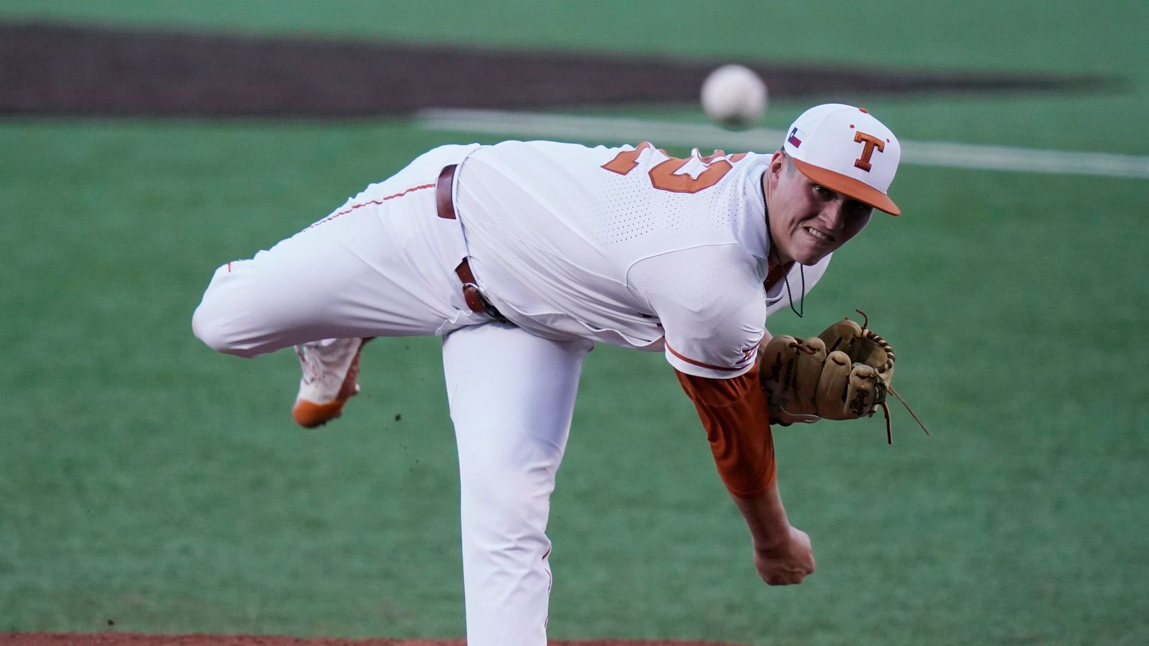 Texas' Ty Madden delivers a pitch against Arizona State in the first inning of Game 4 of the NCAA college baseball regional tournament, Saturday, June 5, 2021, in Austin, Texas.