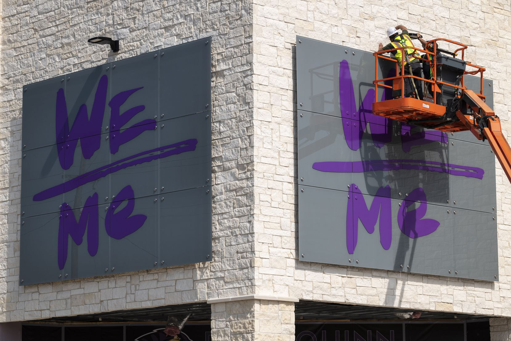 Workers installed a sign outside the health and wellness center at Paul Quinn College on Monday in Dallas. The center is one of the first new buildings on campus in 40 years.