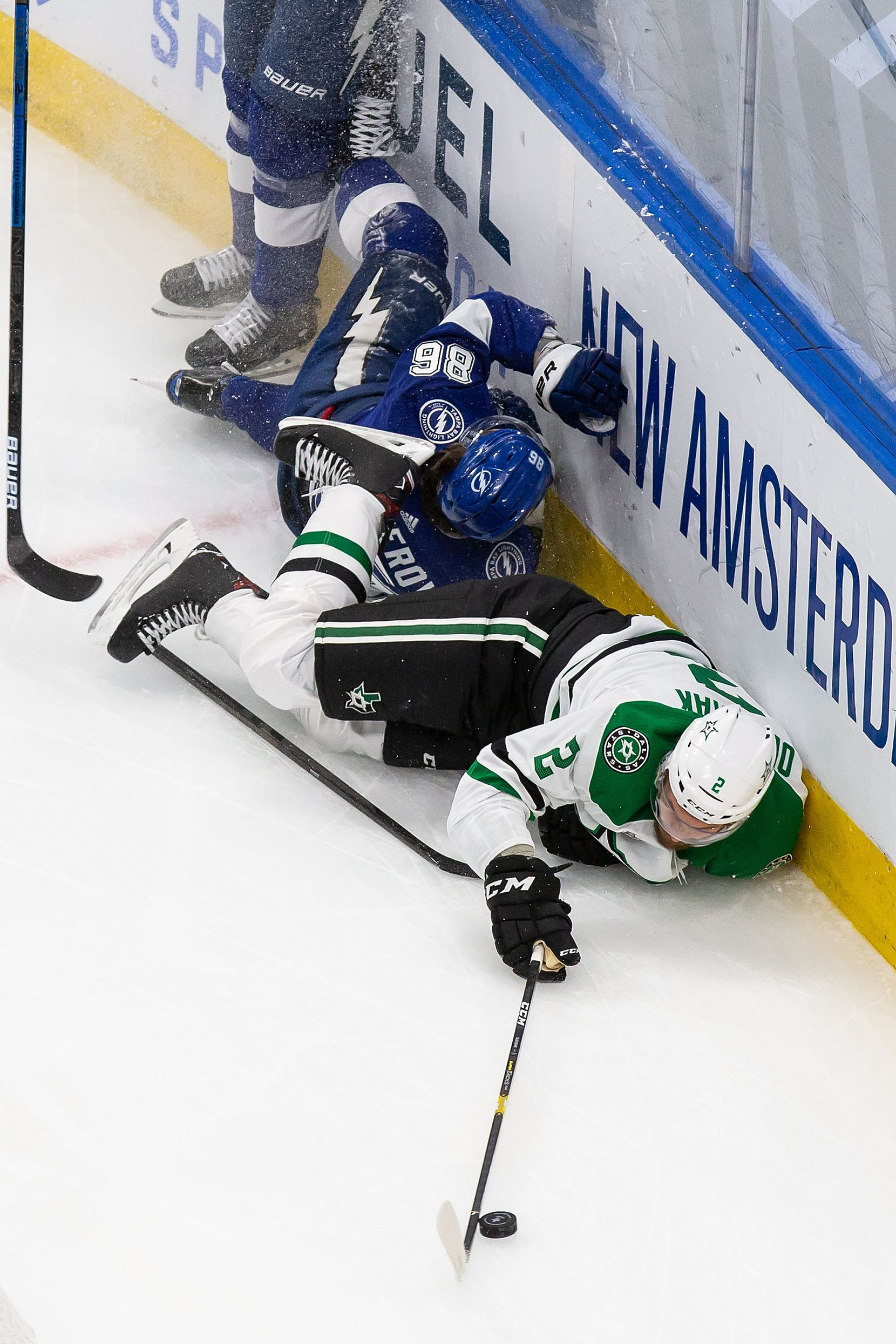 Jamie Oleksiak (2) of the Dallas Stars collides with Nikita Kucherov (86) of the Tampa Bay Lightning during Game Two of the Stanley Cup Final at Rogers Place in Edmonton, Alberta, Canada on Monday, September 21, 2020. (Codie McLachlan/Special Contributor)