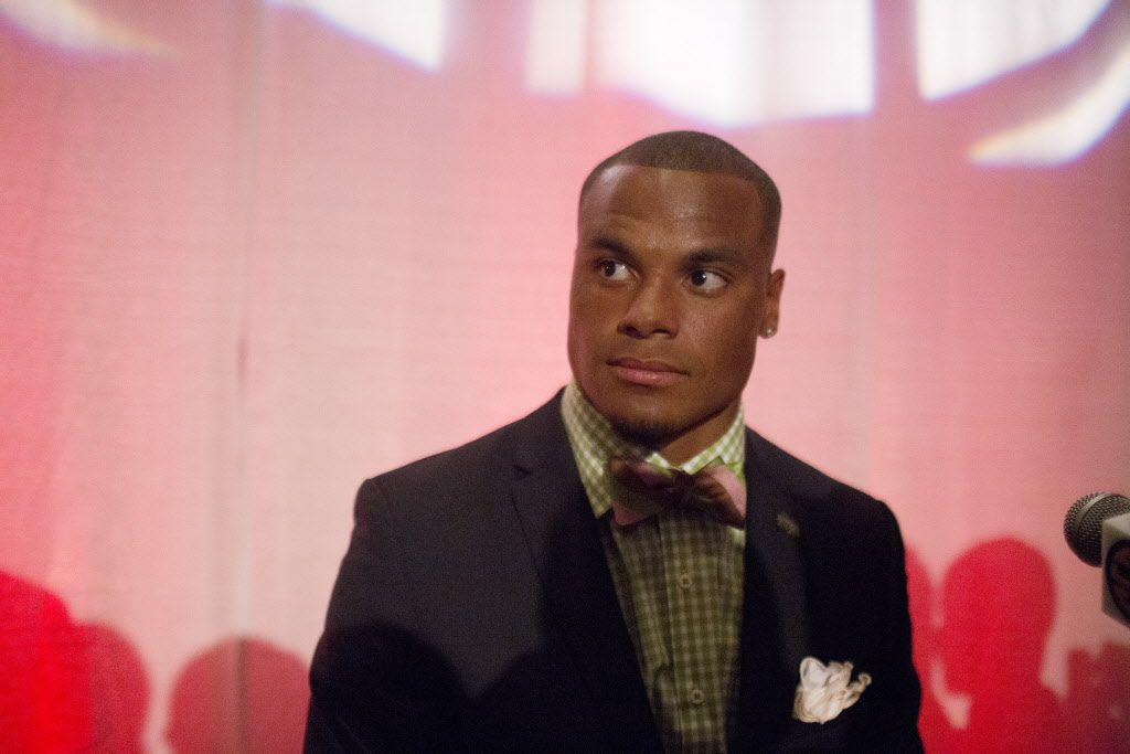 Mississippi State quarterback Dak Prescott  speaks to the media at the Southeastern Conference NCAA college football media days, Tuesday, July 14, 2015, in Hoover, Ala. (AP Photo/Brynn Anderson)   ORG XMIT: OTKBA
