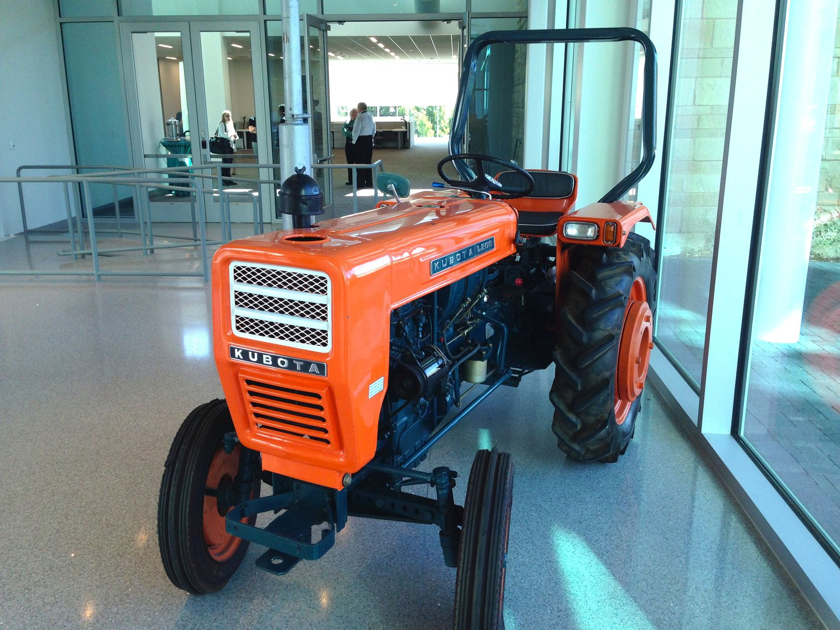 An example of the first Kubota Tractor model sold int the U.S. in 1972 - the L 200 - sits in the lobby of the company's new Grapevine headquarters.