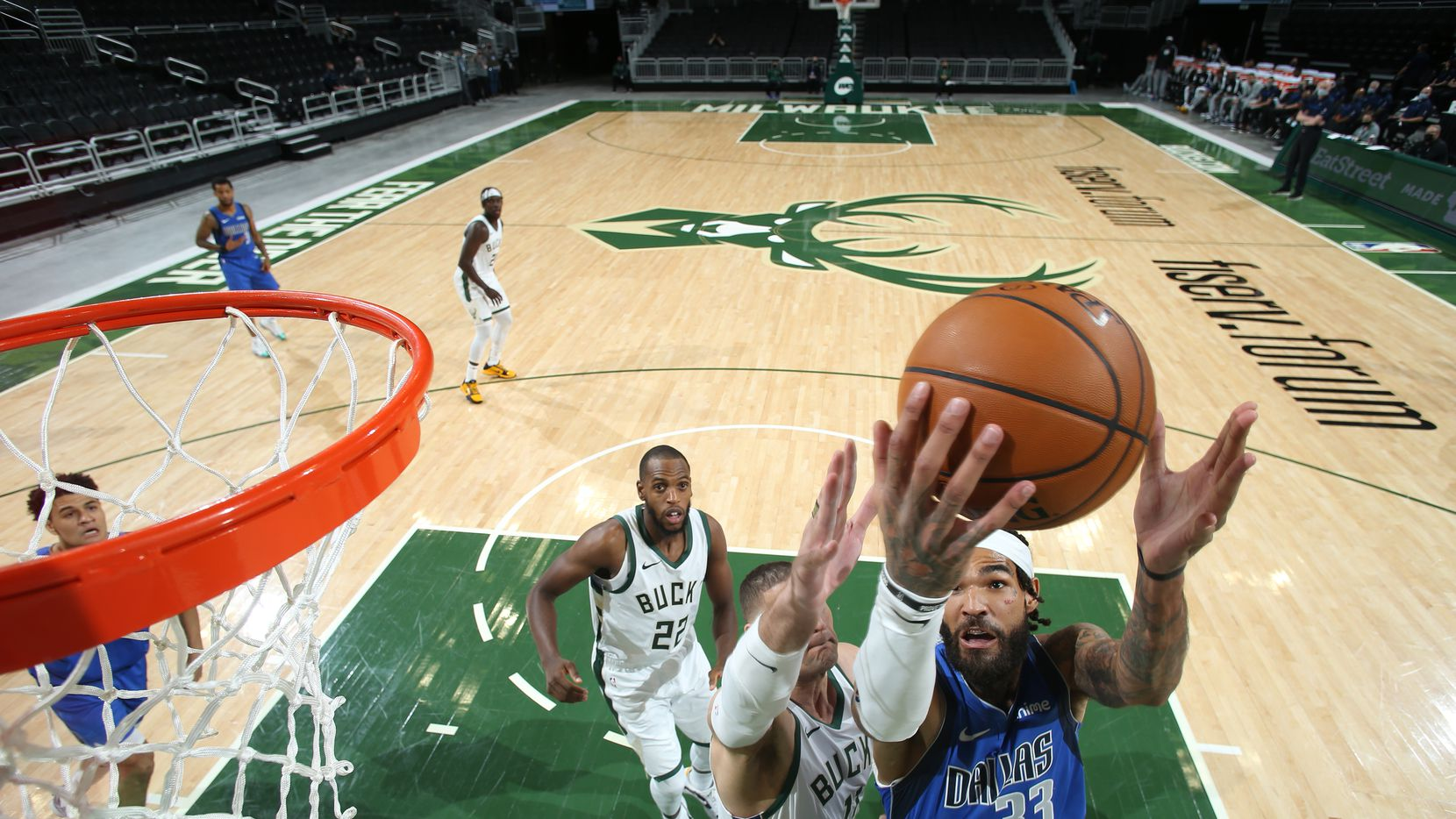 MILWAUKEE, WI - December 12: Willie Cauley-Stein #33 of the Dallas Mavericks shoots the ball against the Milwaukee Bucks during a preseason game on December 12, 2020 at the Fiserv Forum Center in Milwaukee, Wisconsin. NOTE TO USER: User expressly acknowledges and agrees that, by downloading and or using this Photograph, user is consenting to the terms and conditions of the Getty Images License Agreement. Mandatory Copyright Notice: Copyright 2020 NBAE