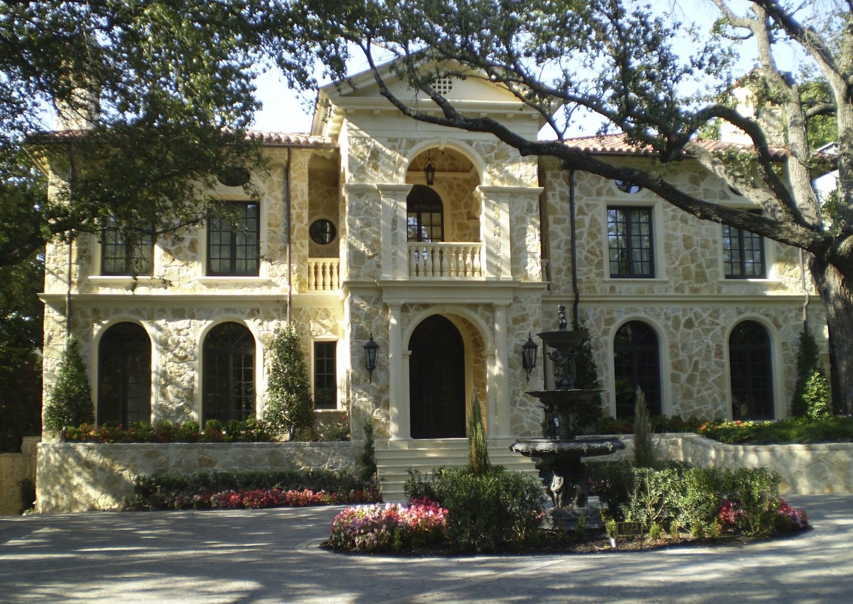 The house at 4223 Bordeaux has eight fireplaces, a six-car garage, a media room, a full gym and a wine cellar.
