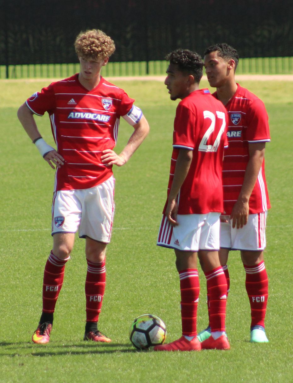 Chris Cappis (left), Jesus Ferreira (#27), and Brandon Servania (right) await kickoff against Solar SC in Developmental Academy play. (5-6-18)