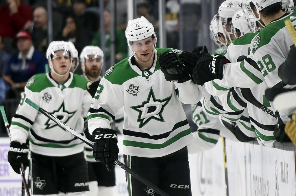 Dallas Stars center Radek Faksa (12) celebrates with his team after scoring a goal against the Vegas Golden Knights during the second period of an NHL hockey game, Tuesday, Nov. 28, 2017, in Las Vegas. (AP Photo/David Becker)