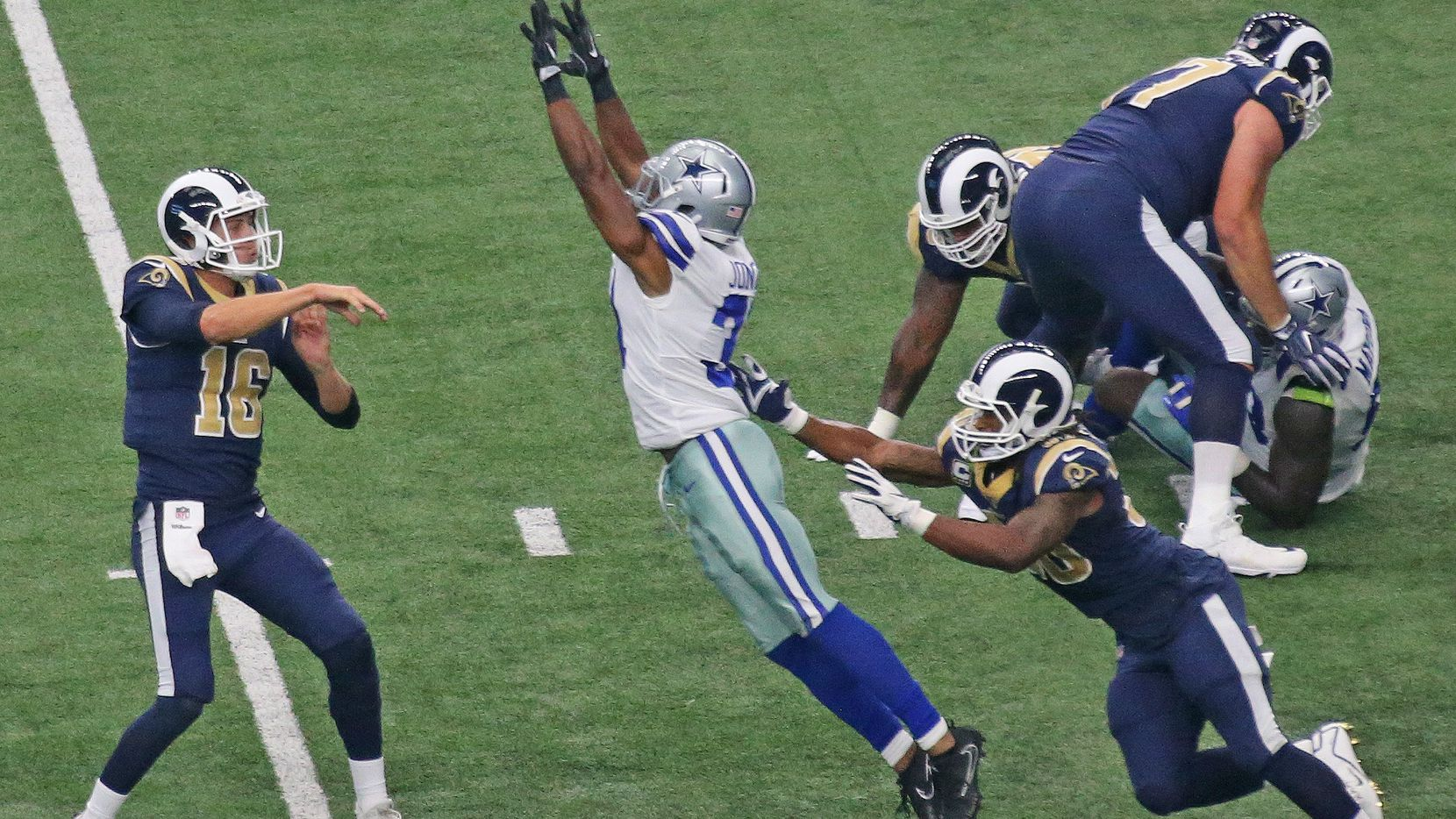 Dallas Cowboys free safety Byron Jones (31) pressures Los Angeles Rams quarterback Jared Goff (16) in the first half during the Los Angeles Rams vs. the Dallas Cowboys NFL football game at AT&T Stadium in Arlington on Sunday, October 1, 2017.
