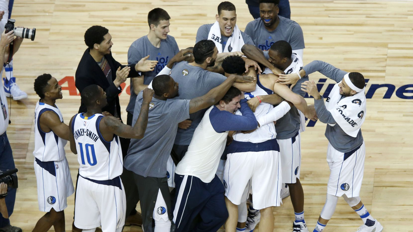 Dallas Mavericks forward Dirk Nowitzki (41) is congratulated by Dallas Mavericks teammates and owner Mark Cuban after surpassing the 30,000 point mark in his career during the second quarter of play at American Airlines Center in Dallas on Tuesday, March 7, 2017. (Vernon Bryant/The Dallas Morning News)
