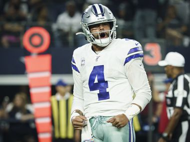 Dallas Cowboys quarterback Dak Prescott (4) celebrates after throwing a touchdown  pass to wide receiver Tavon Austin during the first quarter of an NFL football game against the Philadelphia Eagles at AT&T Stadium on Sunday, Oct. 20, 2019, in Arlington.