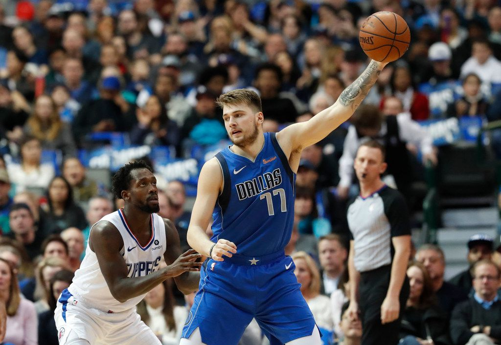 Dallas Mavericks forward Luka Doncic (77) of Germany keeps the ball from LA Clippers guard Patrick Beverley (21) during the first half of an NBA basketball game in Dallas, Tuesday, Jan. 22, 2019. (AP Photo/LM Otero)