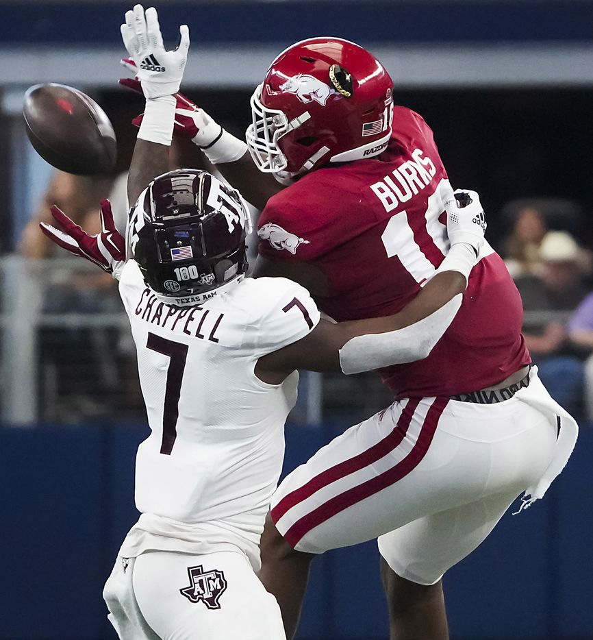 Texas A&M defensive back Tyreek Chappell (7) breaks up a pass intended for Arkansas wide receiver Treylon Burks (16) during the first half of an NCAA football game at AT&T Stadium on Saturday, Sept. 25, 2021, in Arlington. Chappell was called for interference on the play.