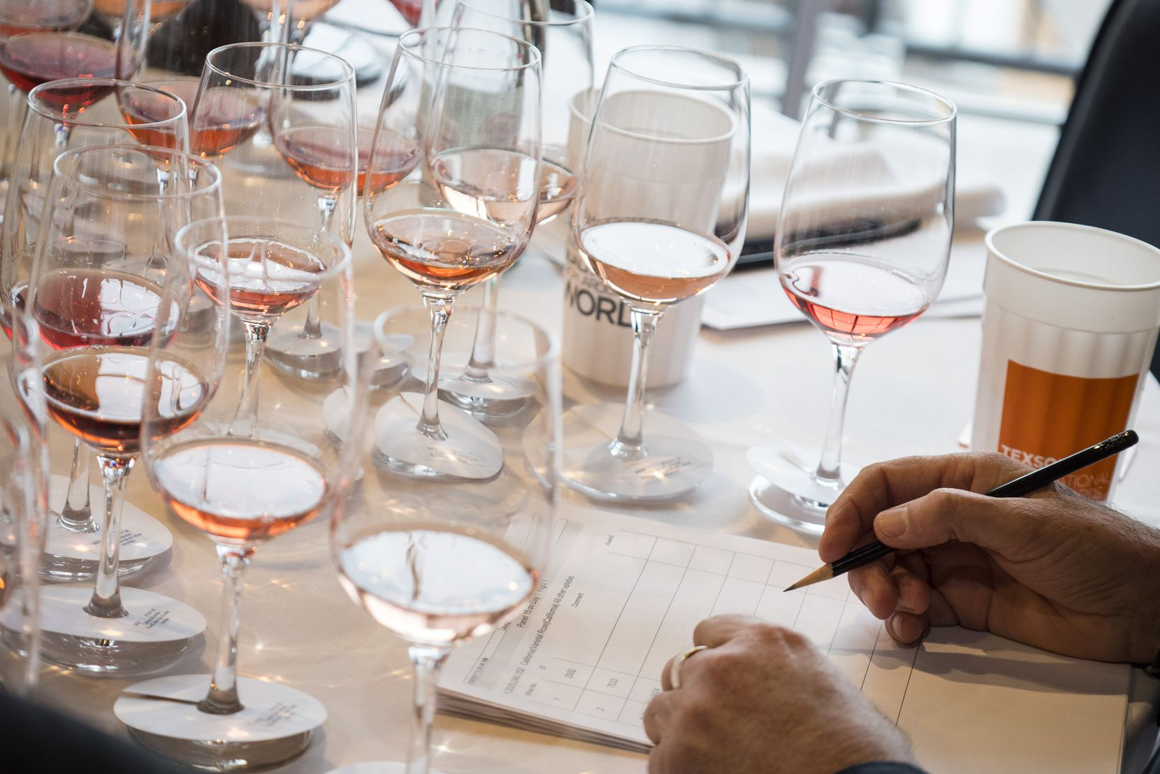 Judges taste wines at the TexSom International Wine Competition in Irving.