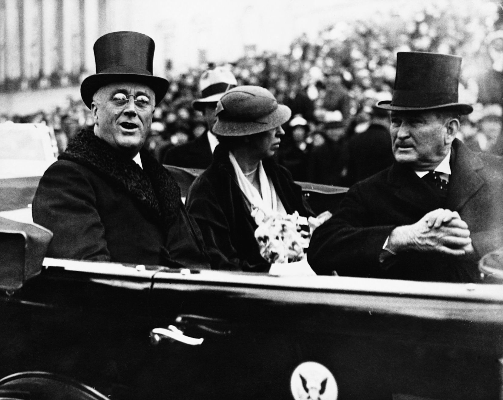 President Franklin Roosevelt and first lady Eleanor Roosevelt leave the Capitol after inaugural ceremonies of March 4, 1933. With them is Sen. Joseph Robinson of Indiana, the Democratic majority leader.