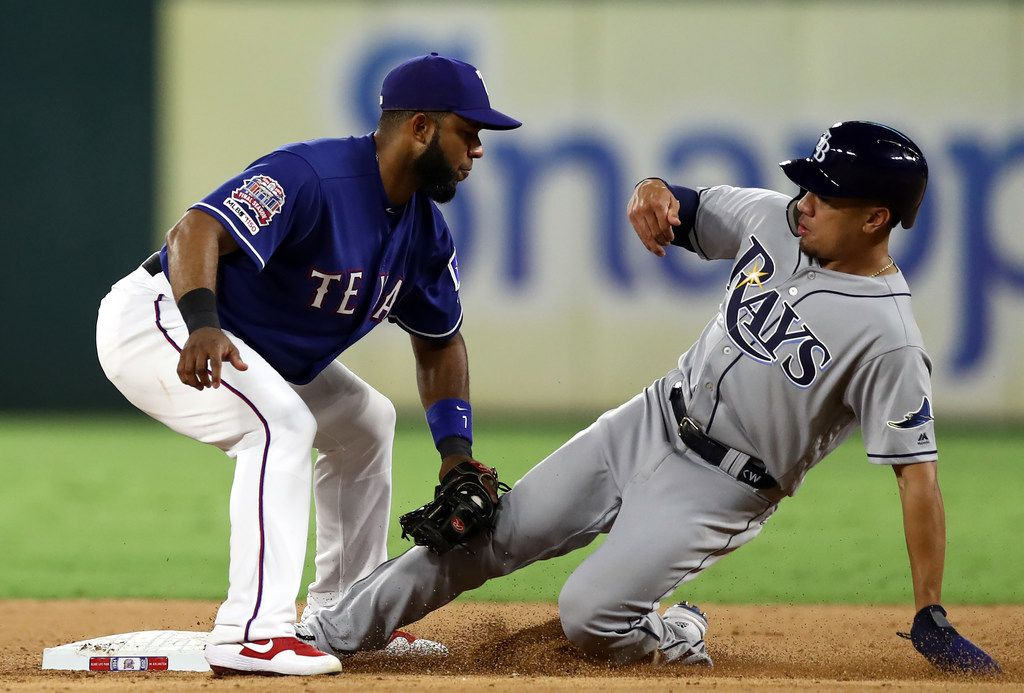 ARLINGTON, TEXAS - SEPTEMBER 10:  Elvis Andrus #1 of the Texas Rangers makes the out on the steal attempt by Kean Wong #31 of the Tampa Bay Rays in the seventh inning at Globe Life Park in Arlington on September 10, 2019 in Arlington, Texas. (Photo by Ronald Martinez/Getty Images)